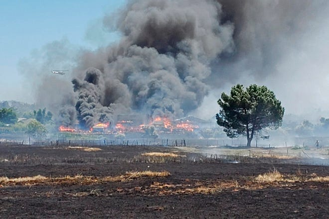 In this photo provided by the California Department of Forestry and Fire Protection, the Nelson Fire burns Wednesday, June 17, 2020, near Oroville, Calif. Some residents of a Northern California county devastated by wildfire in 2018 were under evacuation orders because of a grass fire that has so far destroyed four homes. An evacuation order for parts of Oroville was issued after noon and the cause of the fire is under investigation. A 2018 wildfire in Butte County killed 85 people and destroyed more than 18,000 homes and buildings.