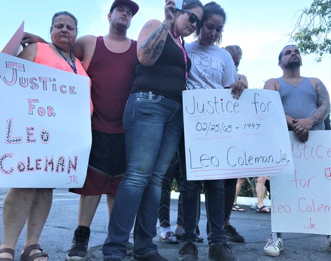 Kayla Olstad, center left, and Taniesha Coleman, pray during a rally seeking justice for Coleman's father, Leo Coleman Jr., who was found hanged to death in an oak tree in Anderson in 1997.