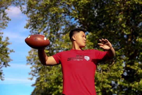 North High School incoming freshman TC Manumaleuna II throws the ball at North High School in Salem, Oregon, on Wednesday, June 17, 2020. Manumaleuna has already received a scholarship offer from the Oregon Ducks.