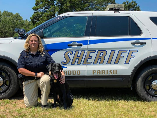 Caddo Parish Senior Deputy Magalene Boykin and K-9 Rougie pose for a photo. On Wednesday, June 17, 2020, Shreveport and Bossier City businesses donated new collars and badges to Caddo Parish Sheriff K-9 teams.