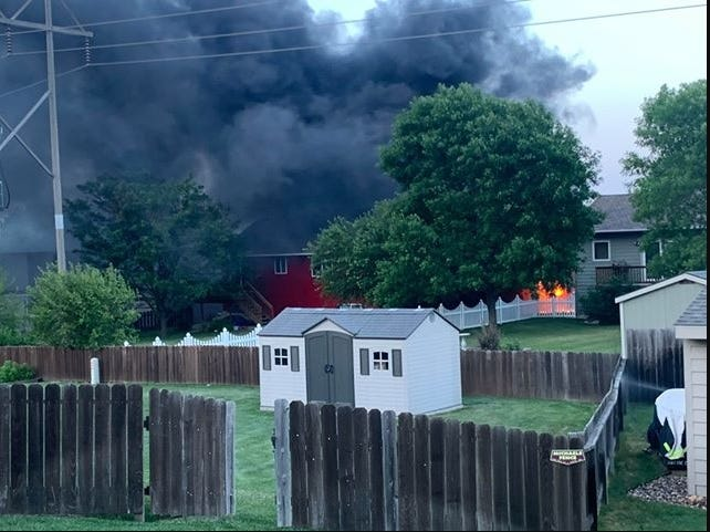 Smoke and flames engulf a garage at about 9 p.m. Wednesday, June 17, 2020, in the 2700 block of South Theodore Avenue