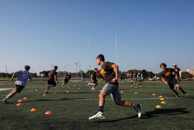 Kickapoo football players run drills during practice at Kickapoo High School on  June 11, 2020.