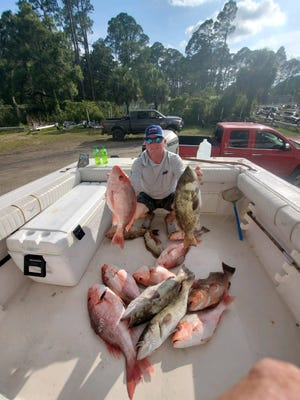 Opening day success as Jeremy Compton shows off the boat load of reef fish caught with Allen Mayer while fishing with Keith Taylor.