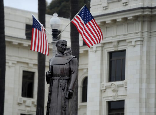The statue of Father Junipero Serra stands in front of Ventura City Hall.