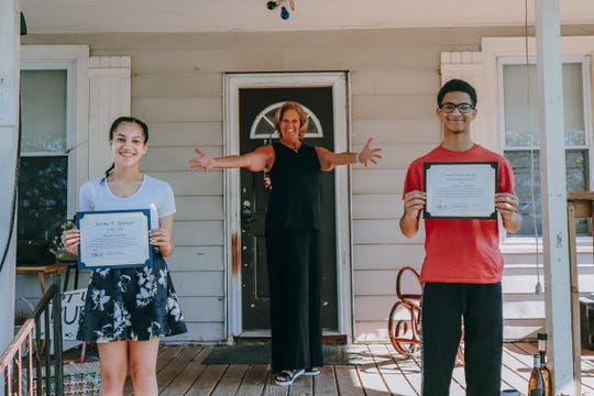 Kimberly Chapman, artistic director, Vineland Regional Dance Company, recently presented Alyssa and Logan Littleton of Clayton with VRDC scholarships to support participation inaccredited summer dance programs held throughout the U.S.