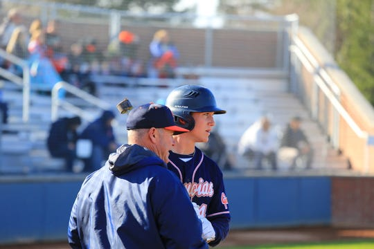 College of the Sequoias' head baseball coach Jody Allen, left, talks with his son, Payton, during a Giants' game.