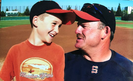 College of the Sequoias head baseball coach Jody Allen with his son, Payton, at the Giants' ballpark.