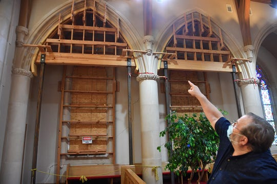 Don Stribling, pastor of New Hope Presbyterian Church, points out structural issues in the sanctuary of the 70-year-old Fain Presbyterian Church building.