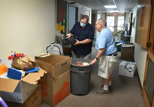 New Hope Presbyterian Church pastor Don Stribling, left, and longtime church member Allyn Arnold help pack items before moving out of the Fain Presbyterian Church building. Sunday will be the last worship service there.