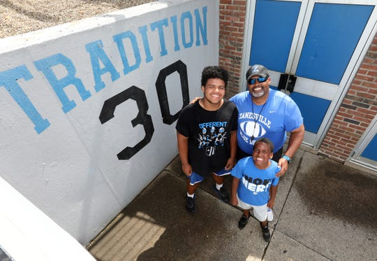 Zanesville High School assistant football coach Chad Jackson and his sons Julian, left, and Creed.
