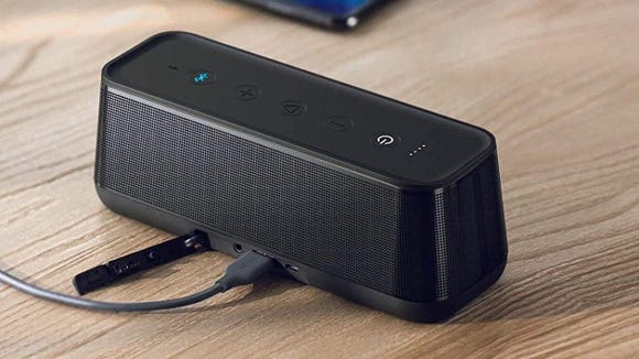 This portable speaker has room to charge your phone.