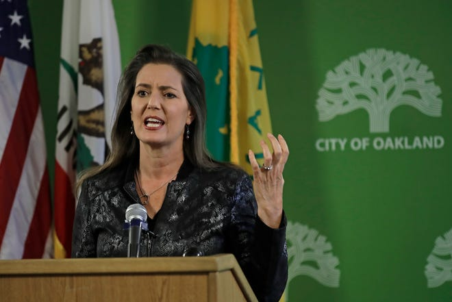 Oakland Mayor Libby Schaaf gestures while speaking during a press conference on Wednesday after the discovery of nooses on five trees at a city park.