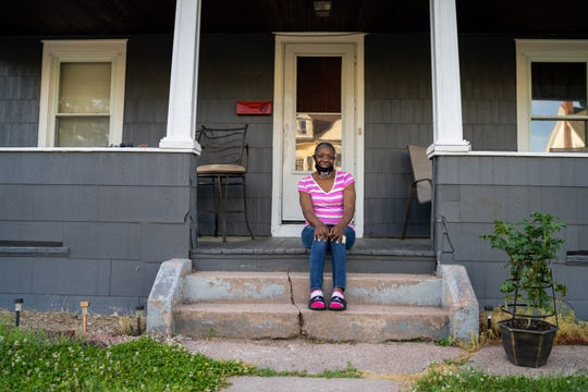 Carla Mitchell, 53, sits outside her Manchester, Conn., home on June 16, 2020. Mitchell receives treatment for bipolar disorder and PTSD at Community Health Resources.