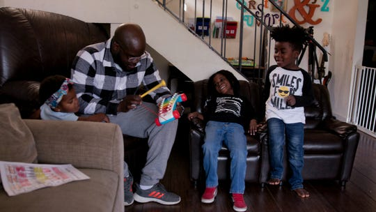 """Glen Henry, who video-blogged raising his kids for the world to see, is profiled in the documentary """"Dads."""""""