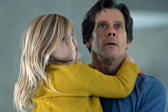 """Theo Conroy (Kevin Bacon) protects daughter Ella (Avery Essex) from sinister forces in """"You Should Have Left."""""""