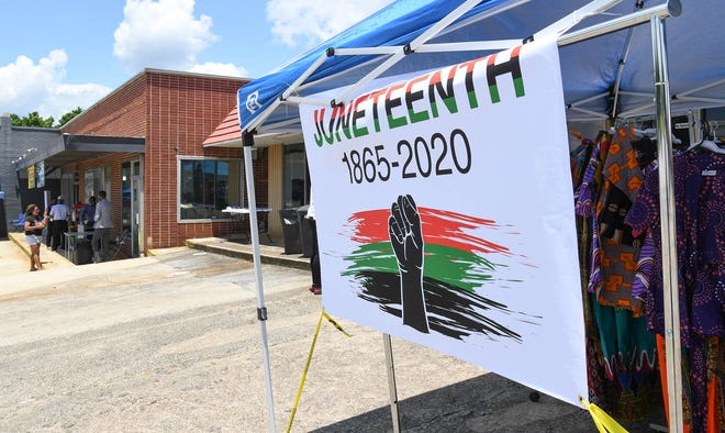 A sign welcoming visitors to Juneteenth Celebration Weekend at Lyndon's Academy of the Arts on Murray Avenue in Anderson Friday, June 19, 2020.
