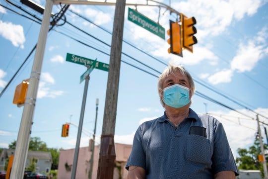 Mayor John Moor stands on Springwood Ave during a Juneteenth celebration Friday, June 19, 2020 in Asbury Park, N.J.