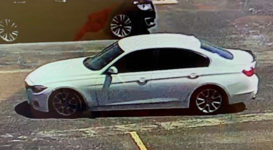 Abilene police released this photo Friday of a white BMW with a black spoiler allegedly driven by two male suspects who tried to scam car lots of keys to later steal the vehicles.