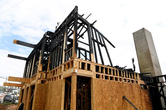 An affordable housing construction site at the corner of Clingman and Hilliard was still smoking on the morning of June 19, 2020 after catching fire overnight.