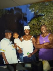 Anthony Little, left, with members of his family.