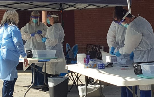 Volunteers from the Hot Springs Health Program joined Madison County Health Department staff for a free, drive-thru testing event in Hot Springs June 11.