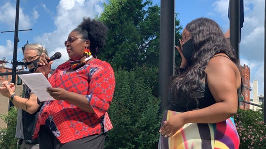 Shanel Boyce, left, speaks to the crowd at a Juneteenth event at Binghamton City Hall. Salka Valerio, right, becomes emotional during the speech.
