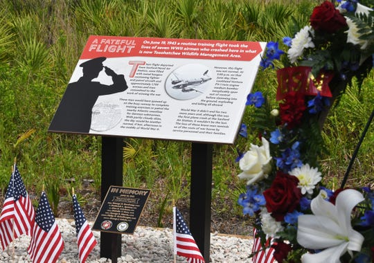 Officials dedicated a memorial plaque to the seven crew members of a World War II bomber who died in a routine training crash in June of 1943 in what is now the Tosohatchee Wildlife Management Area, in Orange County, near Christmas.