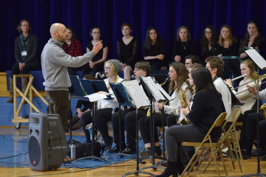 Eric Bushey directs the Bellows Free Academy St. Albans Jazz band during a tour performance.