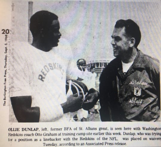 Ollie Dunlap, left, speaks with Washington coach Otto Graham in this Associate Press file photo that ran on Sept. 5 , 1968 editions of the Burlington Free Press.