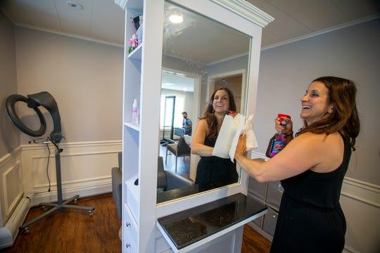 Deana DeRosa, owner of Carpe Diem Salon, prepares the salon for reopening in Far Hills, NJ Friday, June 19, 2020.