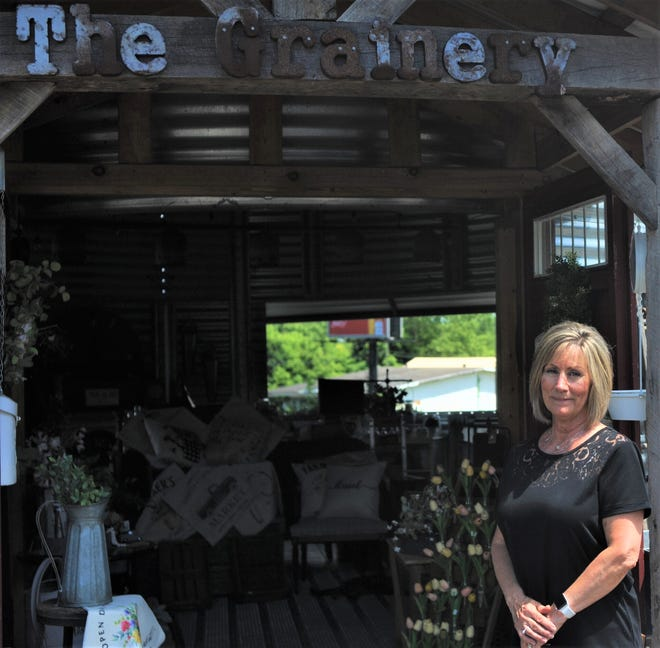 Christy Scheetz owns The Grainery off Ohio 36. Her business offers hanging baskets, as well as garden and home decor.