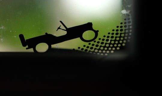 FCA puts small items on Jeep vehicles when they build them known as Jeep's Easter eggs. These are small elements that help convey the human touch behind our products. Now Fiat Chrysler Automobiles has launched a contest to create the next Jeep Easter egg. This is a Jeep climbing the corner of the windshield.