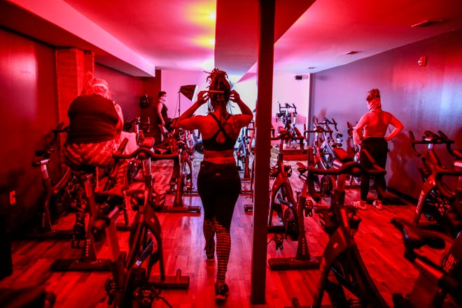 Owner Amina Daniels walks into the indoor cycle studio before leading a class at Live Cycle Delight in the West Village neighborhood of Detroit, photographed on June 17, 2020.