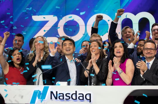 Zoom CEO Eric Yuan, center, celebrates the opening bell at Nasdaq as his company holds its IPO on April 18, 2019, in New York. The videoconferencing company is headquartered in San Jose, Calif.
