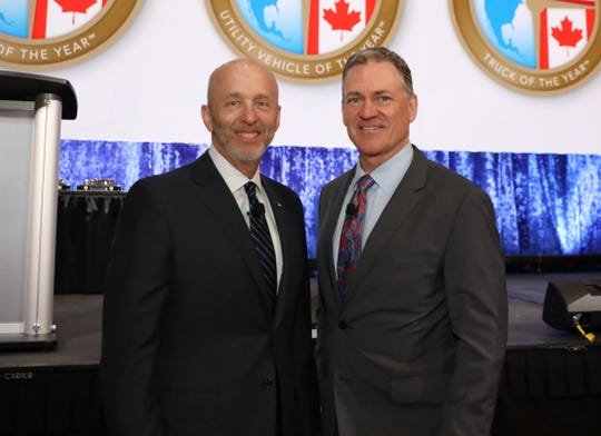 Douglas North, left, of NAIAS 2020 and 2021, with Rod Alberts, executive director of Detroit Auto Dealers Association, which stages the annual North American International Auto Show canceled in 2020 due to pandemic. Photo taken at TCF Center on Jan. 13, 2020.