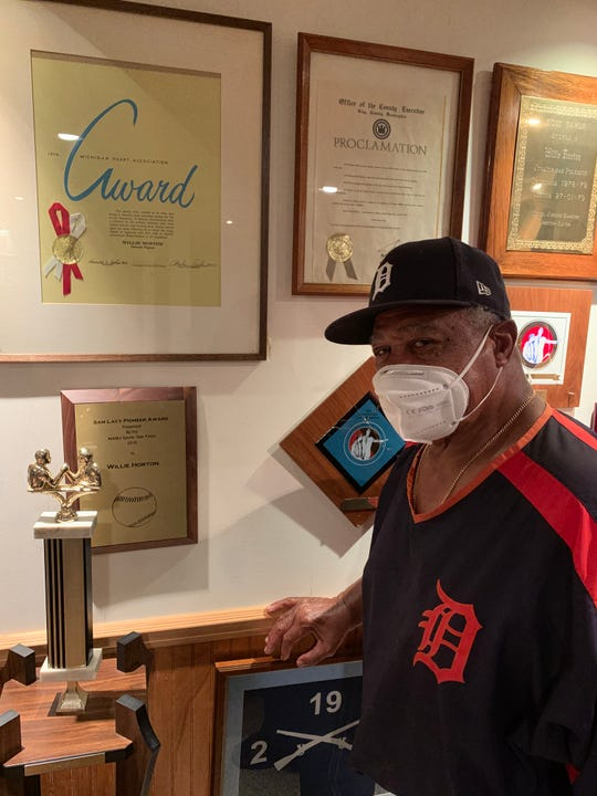Former Tiger Willie Horton stands next to his awards in his Bloomfield Hills home in 2020.