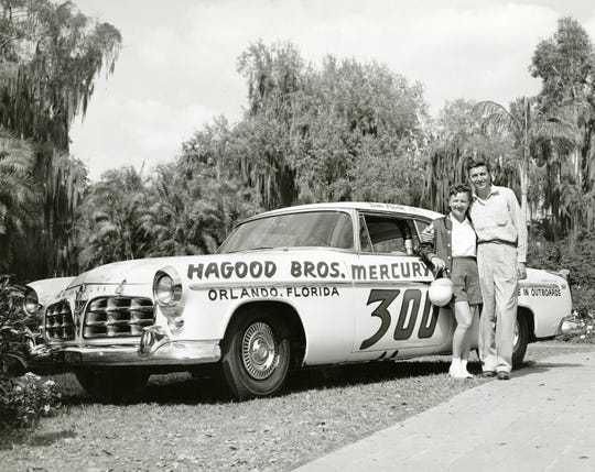 Vicki Wood, pictured next to a 1955 Chrysler 300. Wood was a race car driver and a gender barrier breaker.