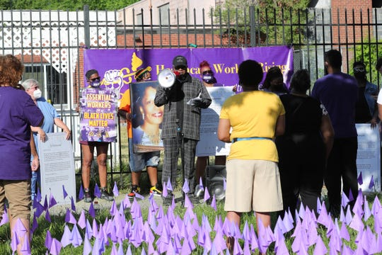 Members of SEIU and community members gathered on East Grand Boulevard to pay respects nursing home residents staff members who died from the COVID-19 virus. 1,900 purple flags were placed at the site to represent those who passed from the virus on June 18, 2020.