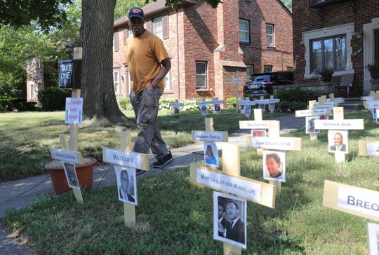Lark Carter stopped by to look at the display in the front yard of John Thorne on June 17, 2020. Thorne has turned his front yard into a display in support of Black Lives Matter. The display includes pictures of not just people who have lost their lives to police brutality but it pays tribute to all African-Americans who have lost their lives to violence.