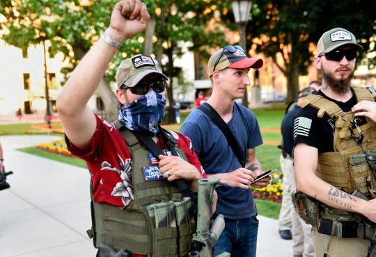 A pair of armed Libertarian constitutionalists show their support for the Black Lives Matter protesters at an American Patriot Rally for Constitutional Rights at the Capitol Building in Lansing, Thursday, June 18.