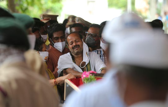 B. Upender weeps by the coffin of his son Colonel B. Santosh Babu in Suryapet, about 140 kilometers from Hyderabad, India, Thursday, June 18, 2020.