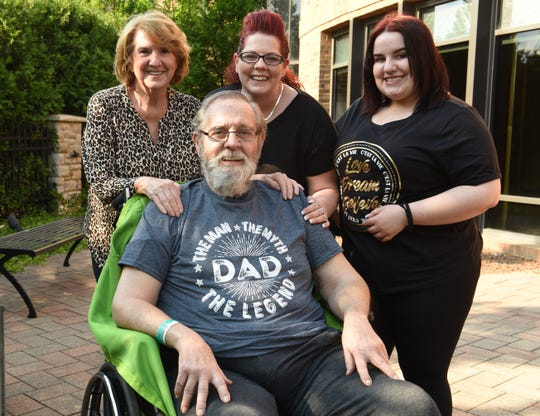 Rich Beckerson, 74, of Dearborn Heights gets a visit Friday, June 19, 2020, at St. Joseph Mercy Ann Arbor Hospital from wife Becky, left, daughter Mandy Beckerson, 39, and granddaughter Trinity Gilliam, 16. Rich is preparing to go home in a few weeks after a long battle with COVID-19.