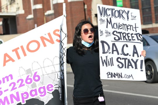 """Fatima Sanchez, 13, of Detroit, chants and marches westbound on Vernor St. with protesters shouting out """"DACA must stay, Trump must go"""" during a celebratory march in support of DACA and the Supreme Court ruling to keep it."""
