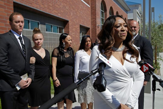 Angela Underwood Jacobs, sister to slain Federal Protective Services Officer Dave Patrick Underwood, right, speaks to media beside family members prior to a memorial service for Underwood on Friday in Pinole, Calif. Underwood was fatally shot as he was guarding the Ronald V. Dellums Federal Building in Oakland, Calif., amid protests on May 29.