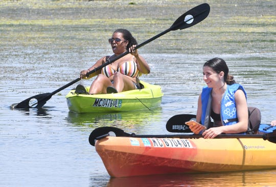 Ryan Dingle and Jessica Topalli paddle  at Lake Saint Clair Metropark in Harrison Township on June 19, 2020.