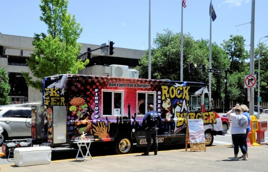 Don't just eat a burger, Rock-A-Burger! The new Rock-A-Burger food truck drew a steady crowd at Evansville's Market on Main on Wednesday, June 10, 2020.