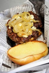A Blue on Black burger with caramelized onions at the Rock-A-Burger food truck on Wednesday, June 10, 2020