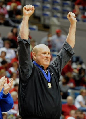 Memorial head coach Bruce Dockery celebrates after the team's 58-50 overtime win over Benton Central during the Class 3A girls' basketball state championship game at the Allen County War Memorial Coliseum in Fort Wayne, Ind., on Saturday, March 5, 2011.