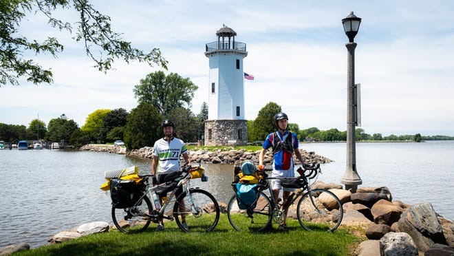 Casey and Joey French pose with their bikes in front of the Fond du Lac lighthouse before starting their 3,000-mile fundraising journey to California.