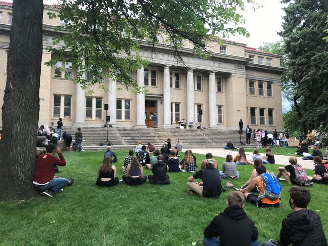 People gather  to listen to a speaker at a Juneteenth celebration at The Oval at Colorado State University on June 19. New Eyes Village, BIPOC Alliance and FOCO Black Lives Matter put on the event.